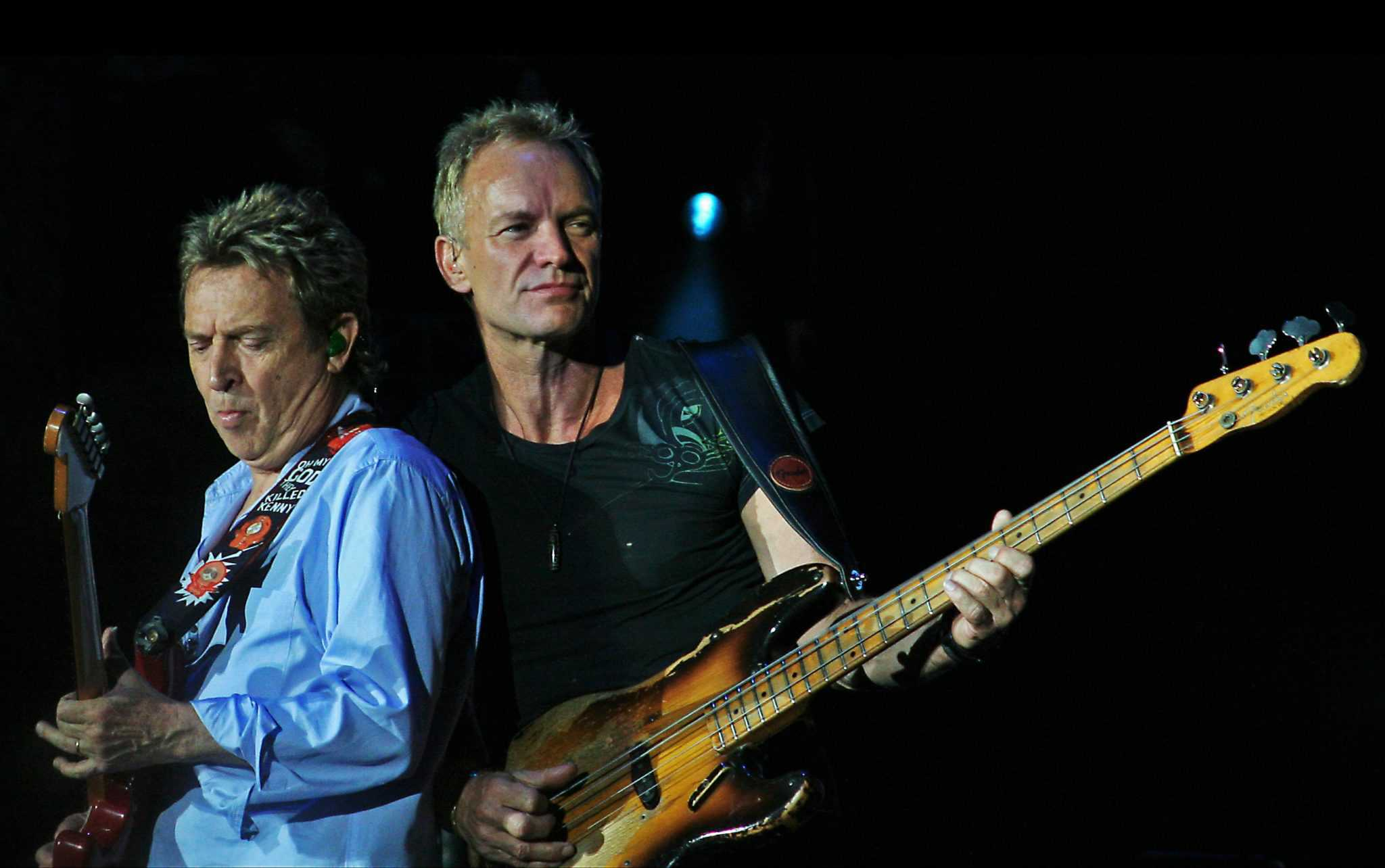 Sting and Andy Summers of The Police on their reunion tour. The band broke up when Sting and the other members could not agree on artistic direction. (Wikipedia)